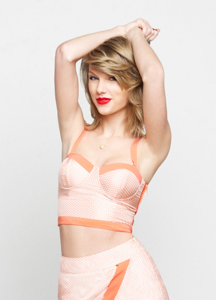 """Taylor Swift poses for her """"1989"""" album photoshoot (2014)."""